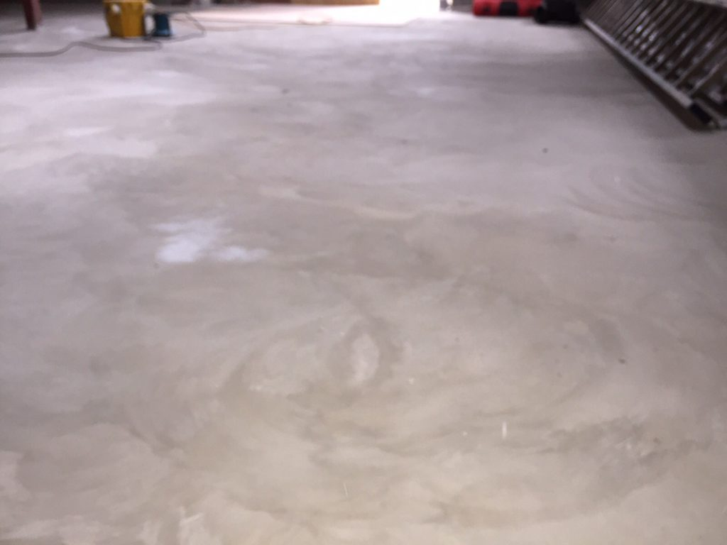 Showing concrete floor before the polishing process beings