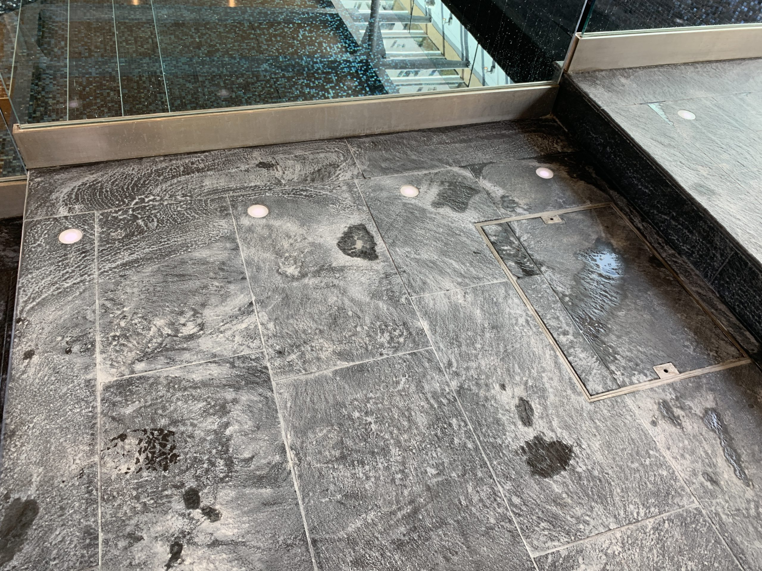 limescale stains on slate swimming pool surround